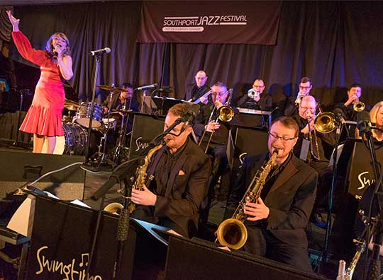 the formation and times of big band jazz group When white musicians like benny goodman added black arrangements for their scores, jazz began to move into the swing or big band period large black and white jazz bands toured the united states filling the radio airwaves with swing, a term which became synonymous with jazz.
